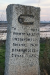 Mileage marker between Marysville and  foothill towns